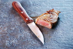 Paring Knife and Juicy Steak Royalty Free Stock Image