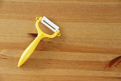 Paring knife. Yellow paring knife for peeling fruit or vegetable. Put on wooden table Royalty Free Stock Photography