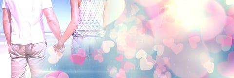 Parinnehavhänder med valentin` s älskar övergångshjärtor royaltyfri bild