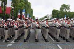 paris Франция 14-ое июля 2012 Ряды чужих legionaries во время времени парада на Champs-Elysees Стоковые Изображения