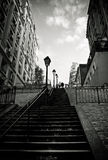 Paris. Long famous Montmartre stairs with traditional old city lamps and couple on the top, Paris, France Royalty Free Stock Photos