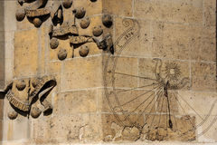 Paris- Abbey of Cluny (detail). Close view of an antique sundial ; bas-relief with carved shells and motto Stock Photography