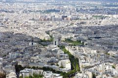Paris from Above. Seen from the Eiffel Tour. In the center is the Arc de Triomphe as figurative centerpoint between two patches of clouds. The lush, tree-lined Stock Photo