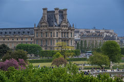 Paris 1. Angled view of the Louvre from a distance nice green treeline foregroung blue sky background Royalty Free Stock Image
