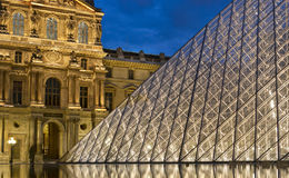 PARIS-APRIL 25: The Louvre at dusk Stock Photography