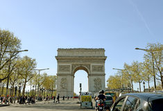 PARIS - APRIL 14, 2015: Traffic flows in the Champs Elysees on early spring, April 14, 2005 in Arc de Triomphe Paris Royalty Free Stock Image