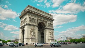 Paris Arc de Triomphe. PARIS, FRANCE - JULY 9, 2015: People and car traffic passing around the Arc de Triomphe in the city center stock footage