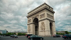 Paris Arc de Triomphe. PARIS, FRANCE - JULY 9, 2015: People and car traffic passing around the Arc de Triomphe in the city center stock video footage