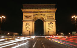 Paris Arc de Triomphe at Night. Arc de Triomphe, or Triumph Arc, in Paris at night with traffic around Royalty Free Stock Photography