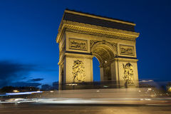 Paris, Arc de Triomphe by night. With strips of vehicles Royalty Free Stock Photo