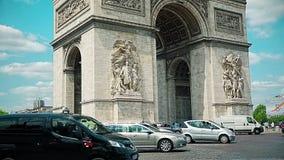 Paris Arc de Triomphe traffic. PARIS, FRANCE - JULY 9, 2015: Traffic around the Arc de Triomphe in the city center, famous monument that honors those who fought stock footage