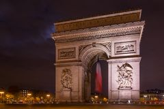 Paris Arc de Triomphe Triumphal Arch at Chaps Elysees at night, Royalty Free Stock Photography