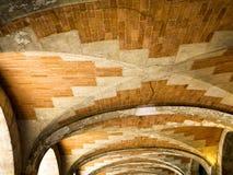 Paris and the arches of Places des Vosges Stock Images