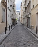 Paris architecture. Old narrow street of Paris, Europe Stock Photography