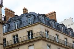 Paris architecture balconies windows and details in French city architectural art in Europe. Sculptures and architect artists Stock Photography