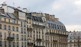 Paris architecture balconies windows and details in French city architectural art in Europe. Sculptures and architect artists Stock Images