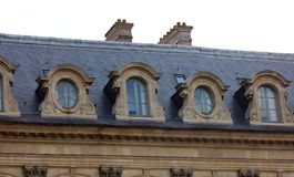 Paris architecture balconies windows and details in French city architectural art in Europe. Sculptures and architect artists Royalty Free Stock Photos