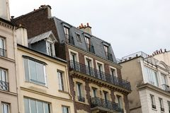 Paris architecture balconies windows and details in French city architectural art in Europe. Sculptures and architect artists Stock Image