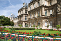 Paris architecture. Paris building with a lawn and flower beds on a summer day royalty free stock photo
