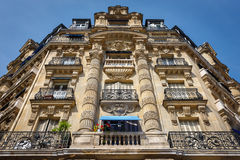 Paris architecture: haussmannian facade and ornaments. Imposing Paris haussmannian building showcasing its typical facade with all its ornaments and Royalty Free Stock Image