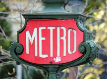 Paris architecture Metro sign in the streets balconies windows and details in French city architectural art in Europe. Paris architecture Metro sign balconies Royalty Free Stock Images