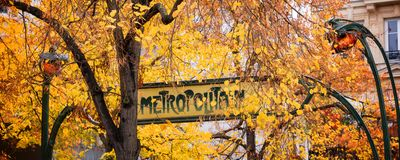 Paris Art nouveau Metropolitain sign in autumn. Panorama royalty free stock images