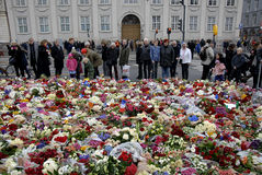 PARIS ATTACKED. Copenhagen/Denmark/ _ 15th November  2015 _Danish police presentspeople laying lofwers vigils and messages in various language at Frenc Embass in Stock Photography
