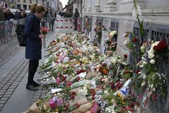 PARIS ATTACKED. Copenhagen/Denmark/ _ 15th November  2015 _French flag at half mast at french Embassy in Copenhagen and Danish police presentspeople laying Stock Photography