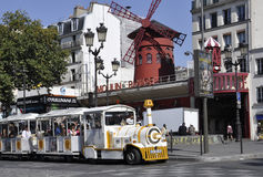 Paris,august 18,2013-Moulin Rouge and Sightseeing Train in Paris Stock Image