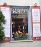 Paris,august 19,2013-Pizzeria window royalty free stock image