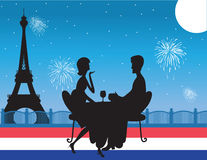 Paris Background. A silhouette of  a romantic couple drinking wine against a backdrop of the Eiffel Tower in Paris. Fireworks are exploding in the sky. The Stock Images