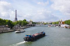 Paris, barge  and eiffel tower Stock Photos