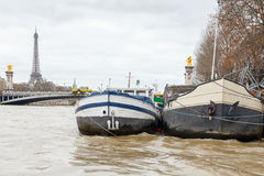 Paris. Barges on the Seine. Stock Photos