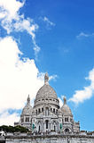 Paris. Basilica domes Sakre-Ker. And cloudy sky Stock Photos