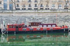 Paris, Bastille, harbor. Houseboats and view on statue royalty free stock photography