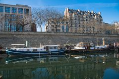 Paris, Bastille, harbor. Houseboats and view on statue stock images