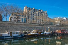 Paris, Bastille, harbor. Houseboats and view on statue stock photos