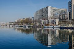 Paris, Bastille, harbor. Houseboats and view on statue royalty free stock image