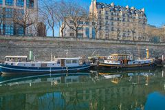 Paris, Bastille. Paris, beautiful Bastille harbor, port with barges stock image