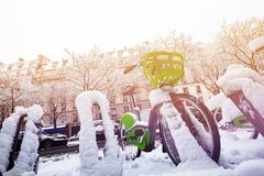 Paris bicycle parking at snowy winter day stock photo