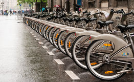 Paris bicycles. The row of bicycle for rent on the street of Paris Stock Images