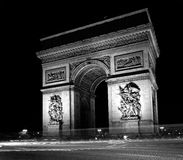 Paris: black and white photo of Arc de triomphe at. France, Paris: black and white photo of Arc de triomphe at night Royalty Free Stock Photos