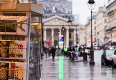 Paris blurred touristic. Touristic view at the city: Paris near the Pantheon with souvenir shop with postcards at the foreground and blurred Pantheon, street Stock Photo