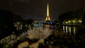 Paris by boat. Seine river point of view from beautiful restaurant boat approaching the Eiffel Tower at night in Paris, France stock video footage