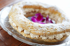 Paris brest. Dessert on a glass plate with very shallow depth of field Royalty Free Stock Photo