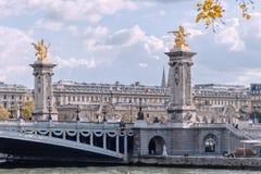 Paris, bridge Alexandre III, the Pegasus. On a background cloudy sky Stock Photo