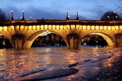 Paris Bridge Pont Neuf Seine river floods. Under the Bridge Pont Neuf New Bridge, the Seine river water level rises above the ordinary level in Paris, France stock photo