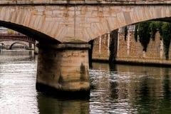 Paris bridges Seine river. Landmark and touristic spot: old stone bridge over the Seine river in Paris, France Royalty Free Stock Images