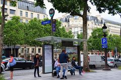 Paris Bus Stop. Bus commuters waiting for the arrival of the bus Stock Image
