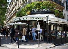 Paris Cafe. Paris, France - July 14, 2011 - Diners enjoy the sun at the famous Cafe de Flore in Paris. The cafe lifestyle draws millions of tourists to Paris Stock Photography